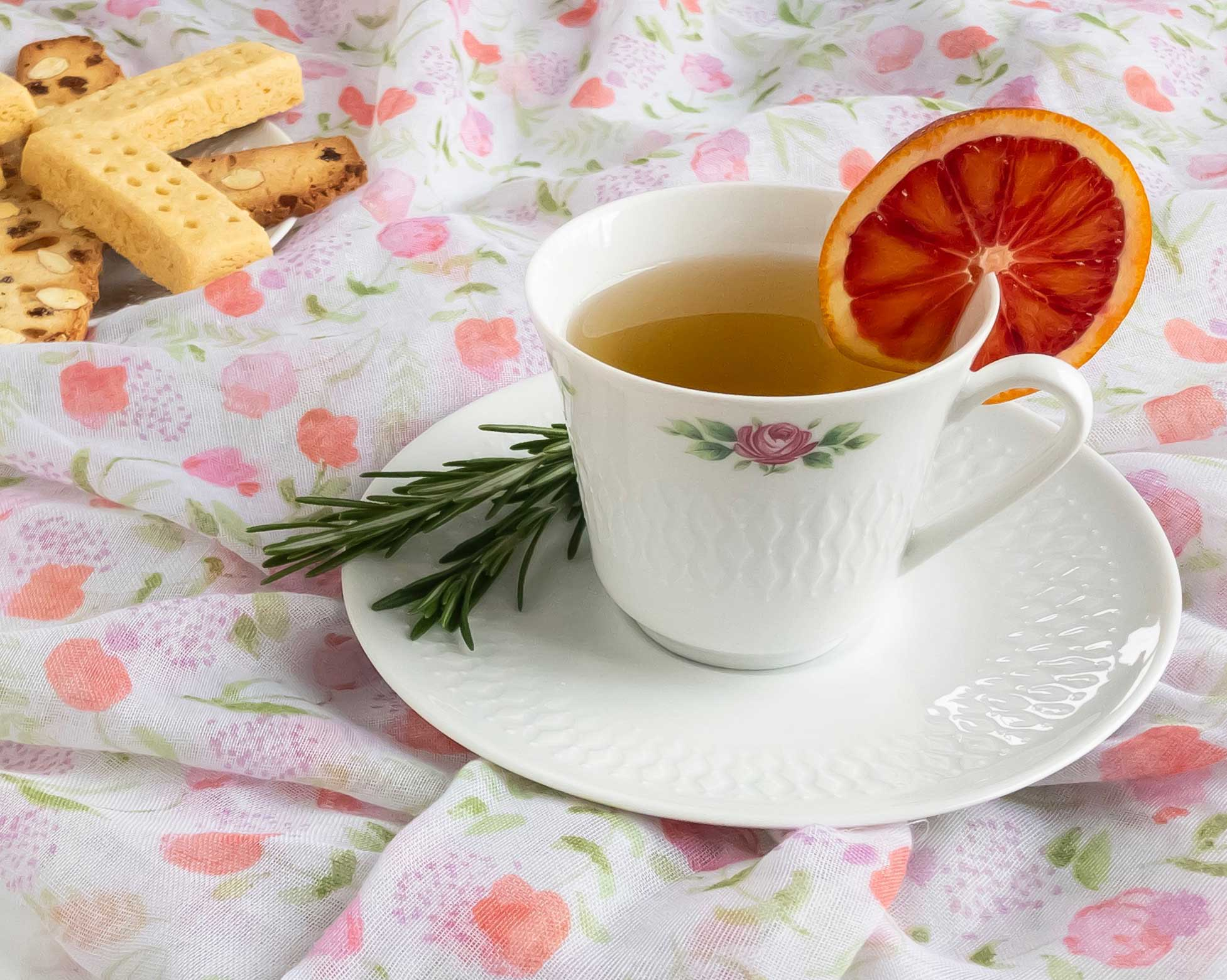 Rosemary Mint Tea, garnished with a blood orange slice