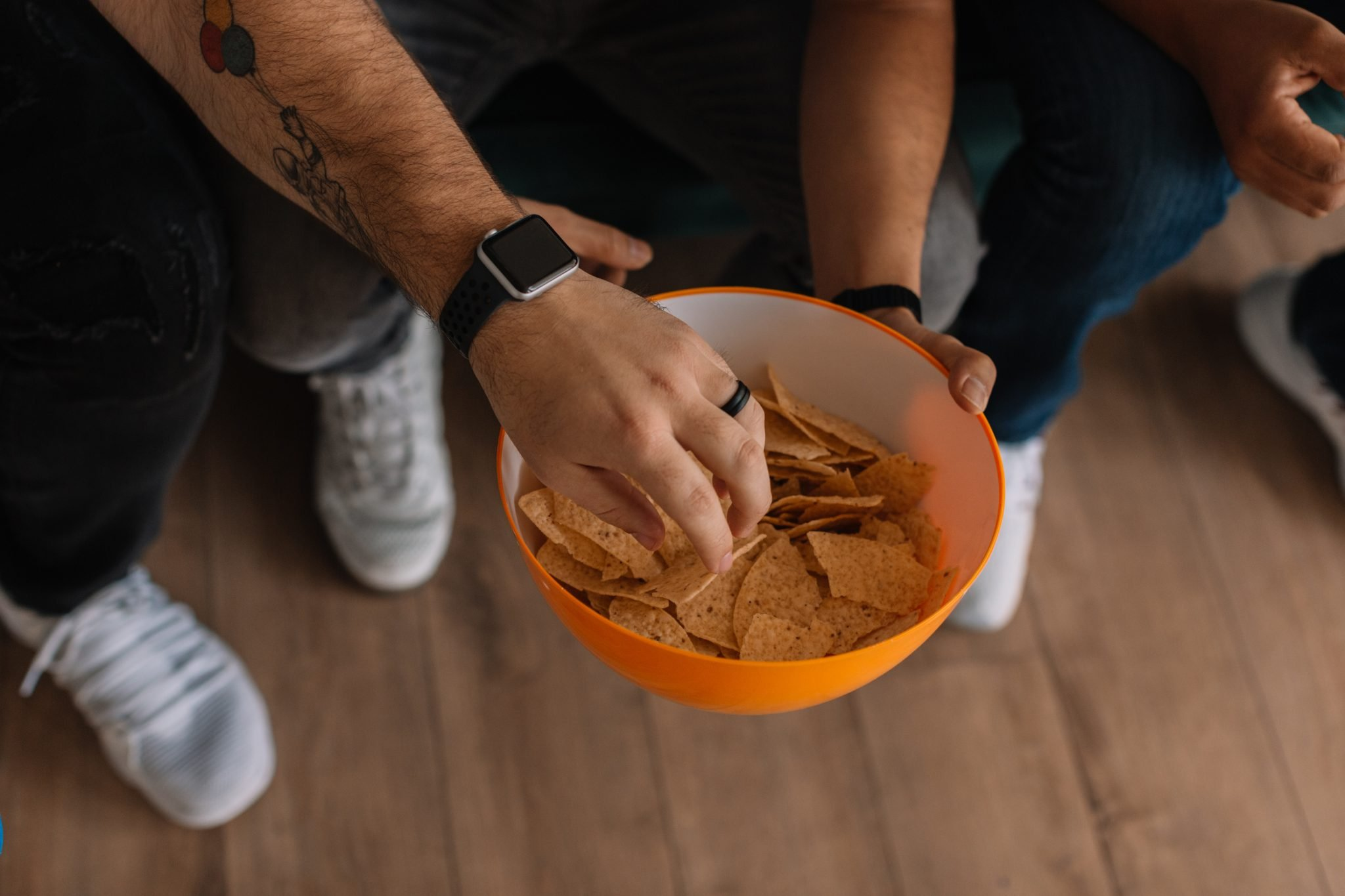 Snacking on chips from a bowl.