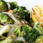 Grilled broccoli and onions close up