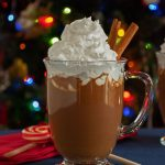 Gingerbread Hot Cocoa in a glass mug with whipped topping