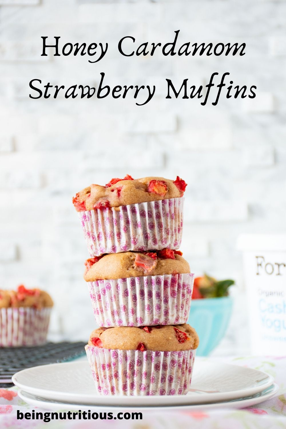 """Stack of 3 strawberry muffins with the words """"Honey Cardamom Strawberry Muffins"""" written above"""