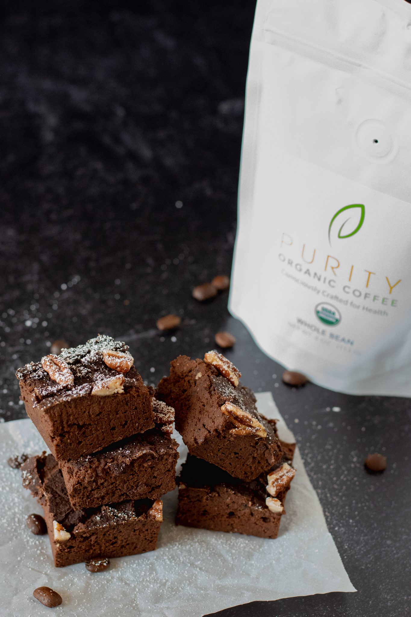 Fudgy Mocha Black Bean Brownies with a bag of Purity Coffee in the background