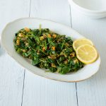 Oval platter of Smoky Sauteed Spinach with 2 lemon slices