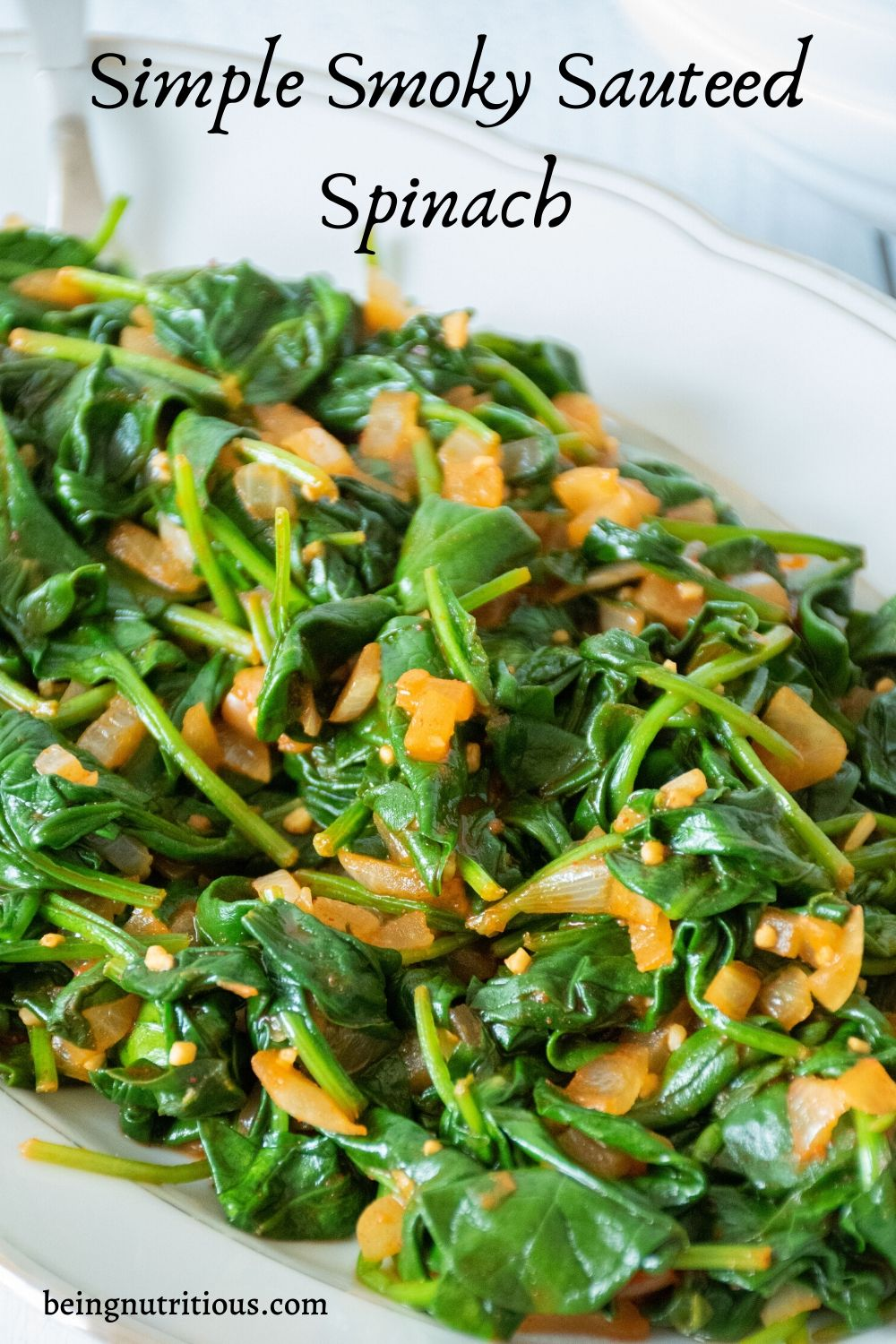 Smoky Sauteed Spinach vertical image with the words 'simple smoky sauteed spinach'
