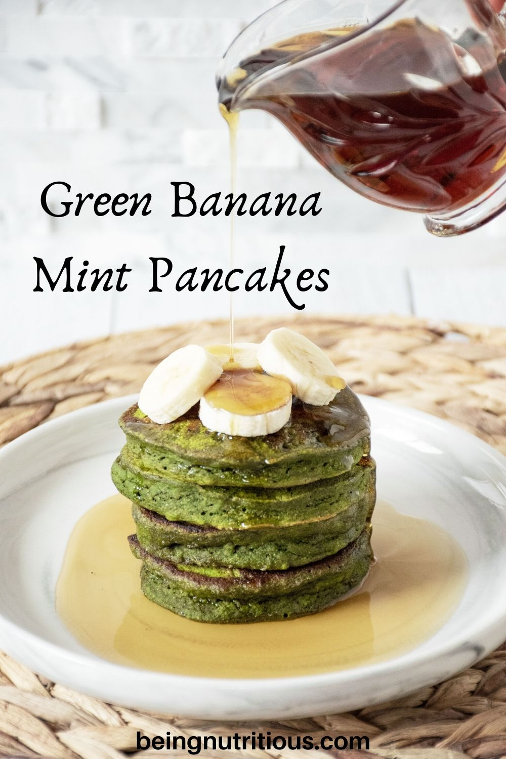 Banana Mint Pancakes on a plate, with banana slices on top, being drizzled with syrup