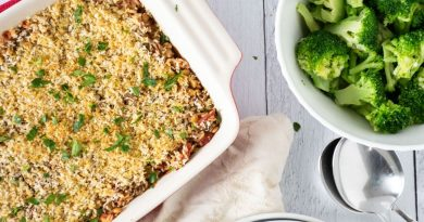 Italian Lentil & Rice casserole in a casserole dish with a side of steamed broccoli