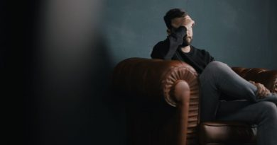 Man sitting on couch alone