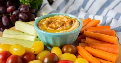 Bowl of hummus with in the middle of a vegetable platter