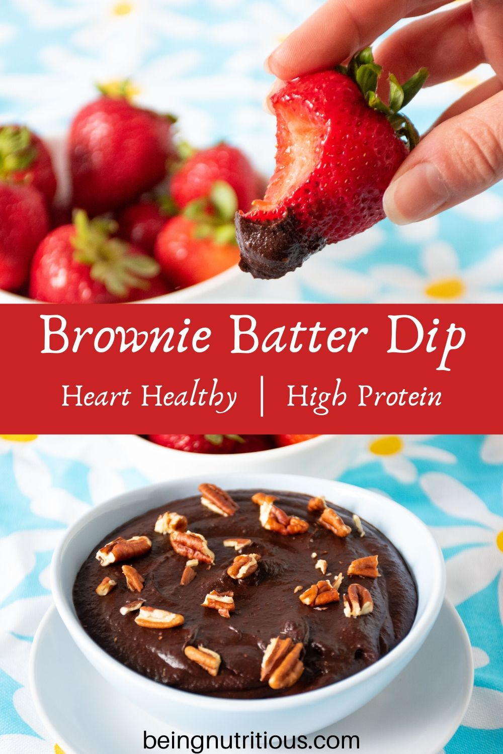 Brownie batter dip in a bowl with a bowl of strawberries behind. A hand holding a strawberry with dip on it and a bite taken out in the foreground.