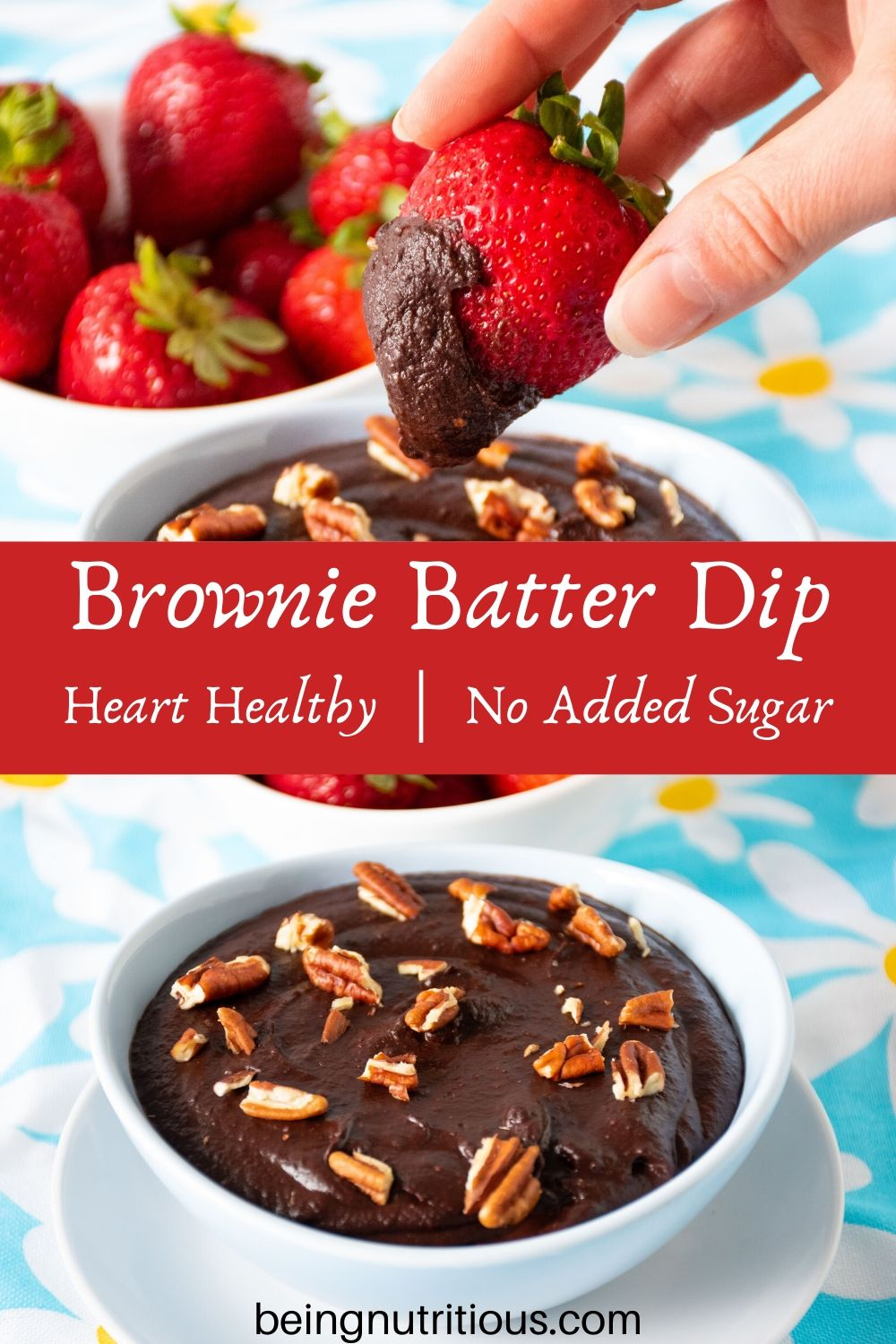 Brownie batter dip in a bowl with a bowl of strawberries behind. A hand holding a strawberry with dip on it in the foreground.
