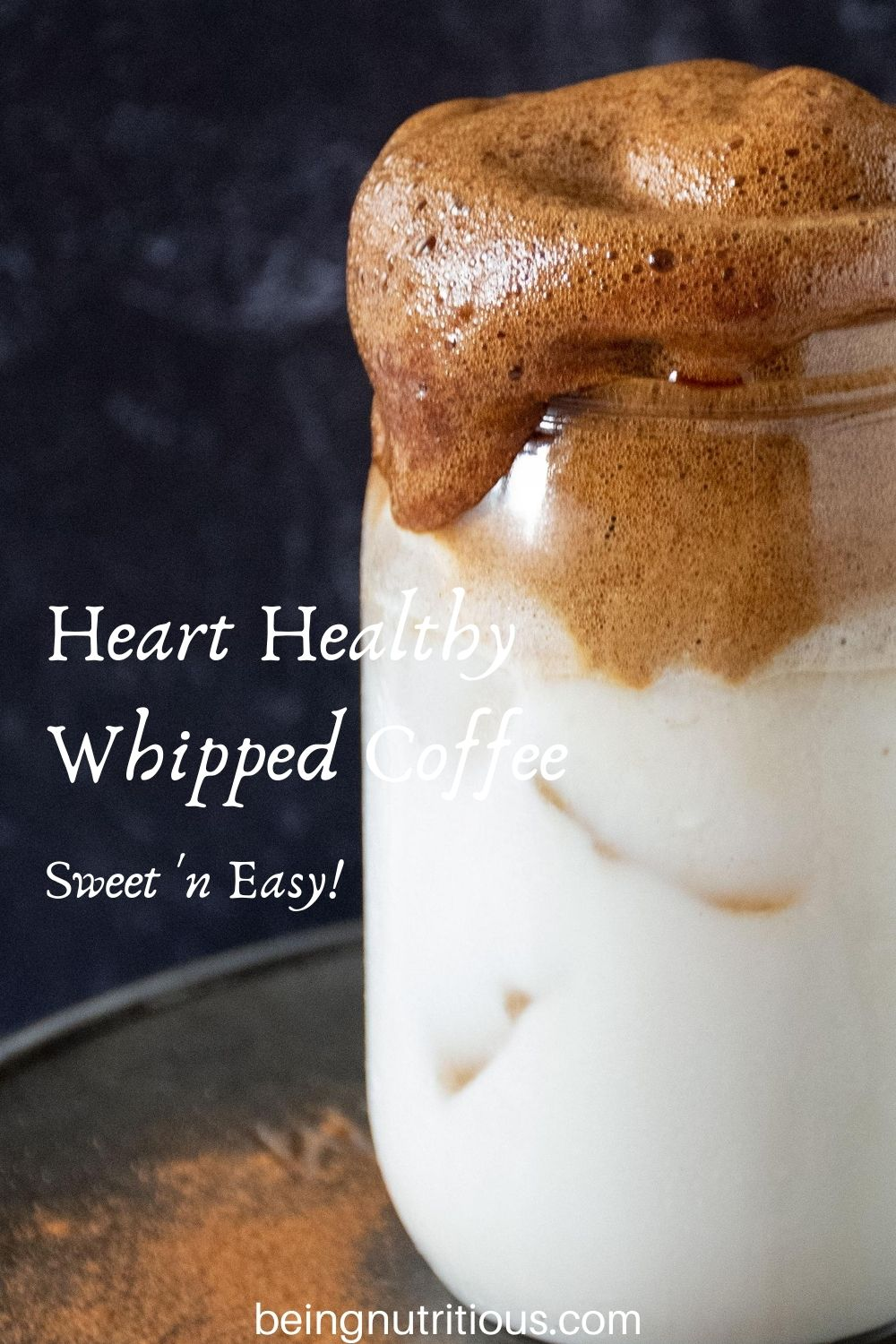 """Close up of whipped coffee over iced almond milk in a Mason jar with text overlay: """"Heart Healthy Whipped Coffee, sweet 'n easy"""""""