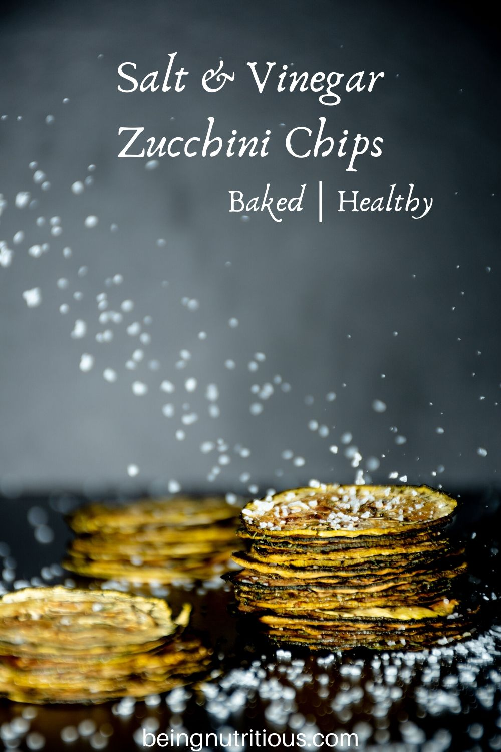 Image of 3 stacks of zucchini chips, with salt crystals falling all around.