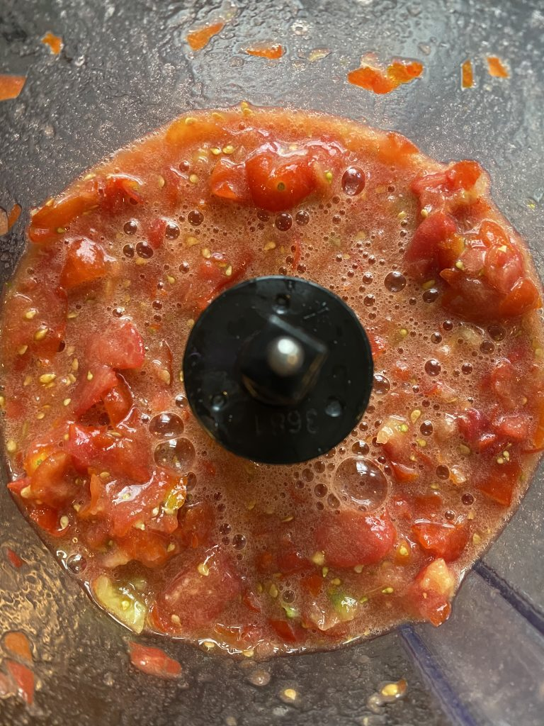 Diced tomatoes in a food processor.