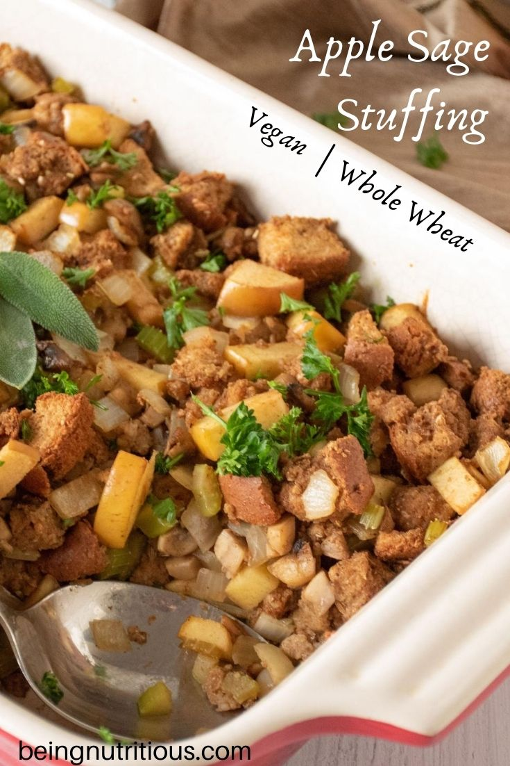 Stuffing in a large casserole dish with a serving spoon. Text overlay: Apple sage stuffing, vegan, whole wheat.