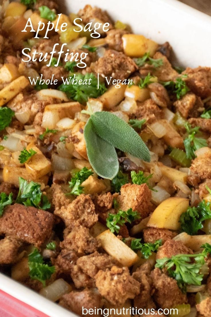 Close up of stuffing, garnished with 2 fresh sage leaves. Text overlay: apple sage stuffing, whole wheat, vegan.