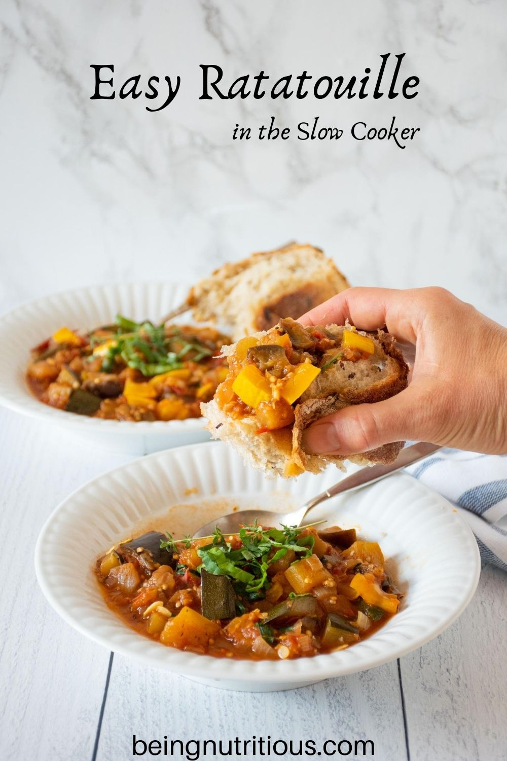 Hand holding a rustic slice of bread, topped with ratatouille, over a bowl of ratatouille. Text overlay: Easy Ratatouille in the Slow Cooker.