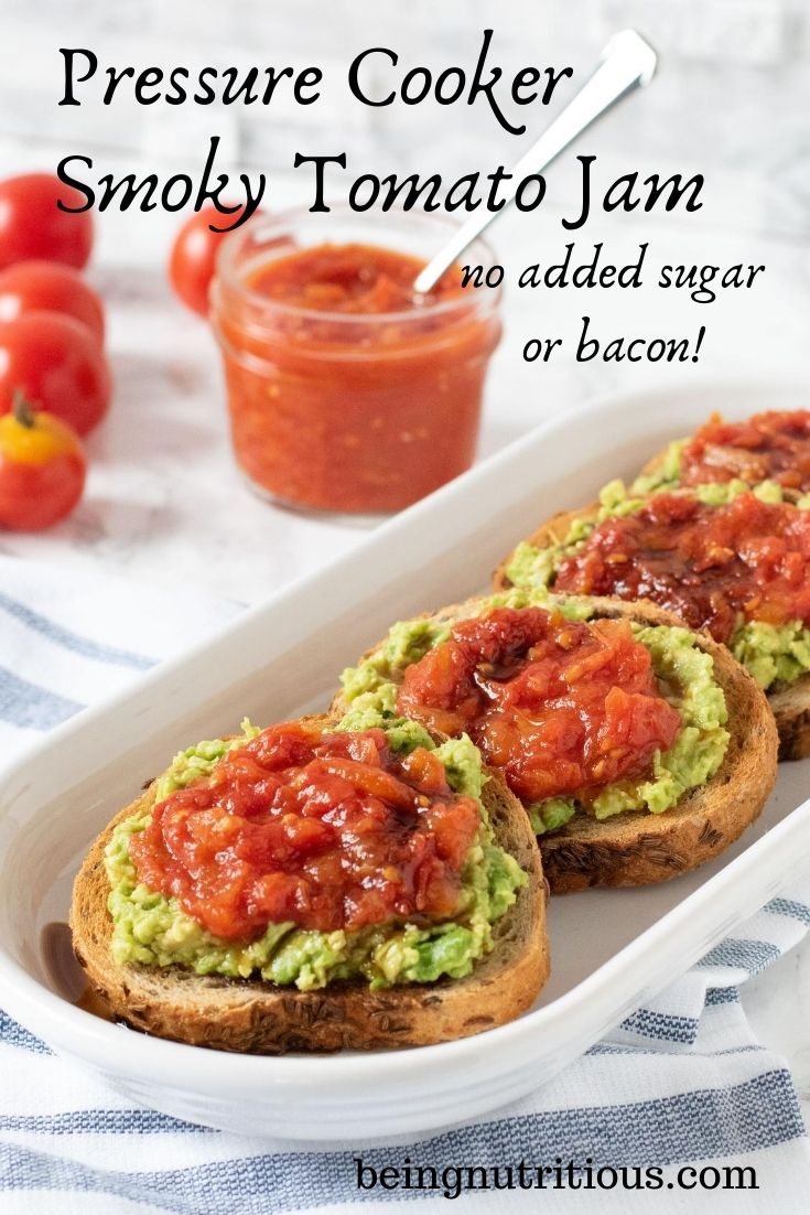 An oval, white dish with 4 round slices of rye bread smeared with avocado, and topped with tomato jam, drizzled with balsamic vinegar. Text overlay: Pressure Cooker Smoky Tomato Jam, no added sugar or bacon.