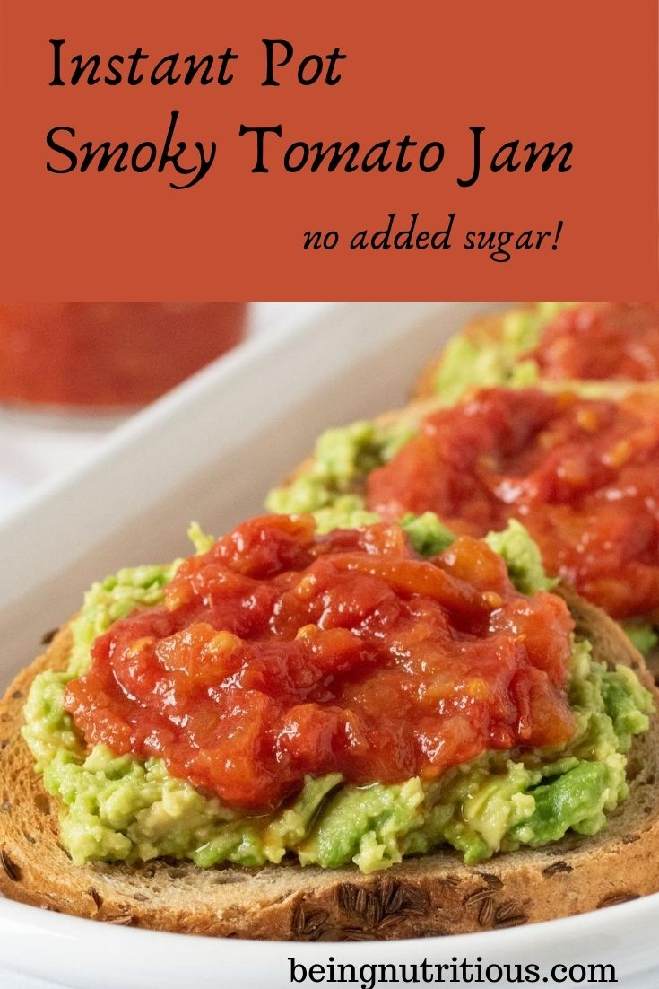 Close up of a round slice of rye bread smeared with avocado, and topped with tomato jam. Text overlay inside a red box: Instant Pot Smoky Tomato Jam, no added sugar.