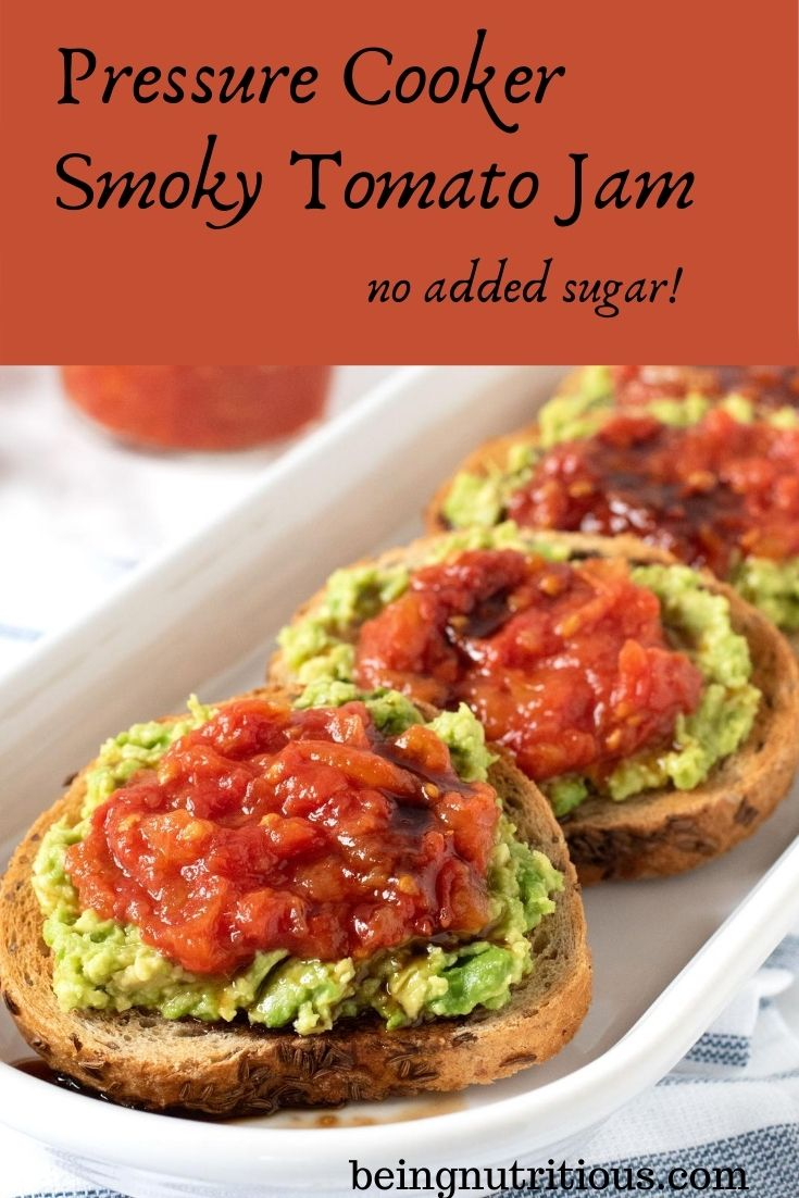 An oval, white dish, with 4 small, round slices of rye bread smeared with avocado, and topped with tomato jam, and drizzled with balsamic vinegar. Text overlay inside a red box: Pressure Cooker Smoky Tomato Jam, no added sugar.