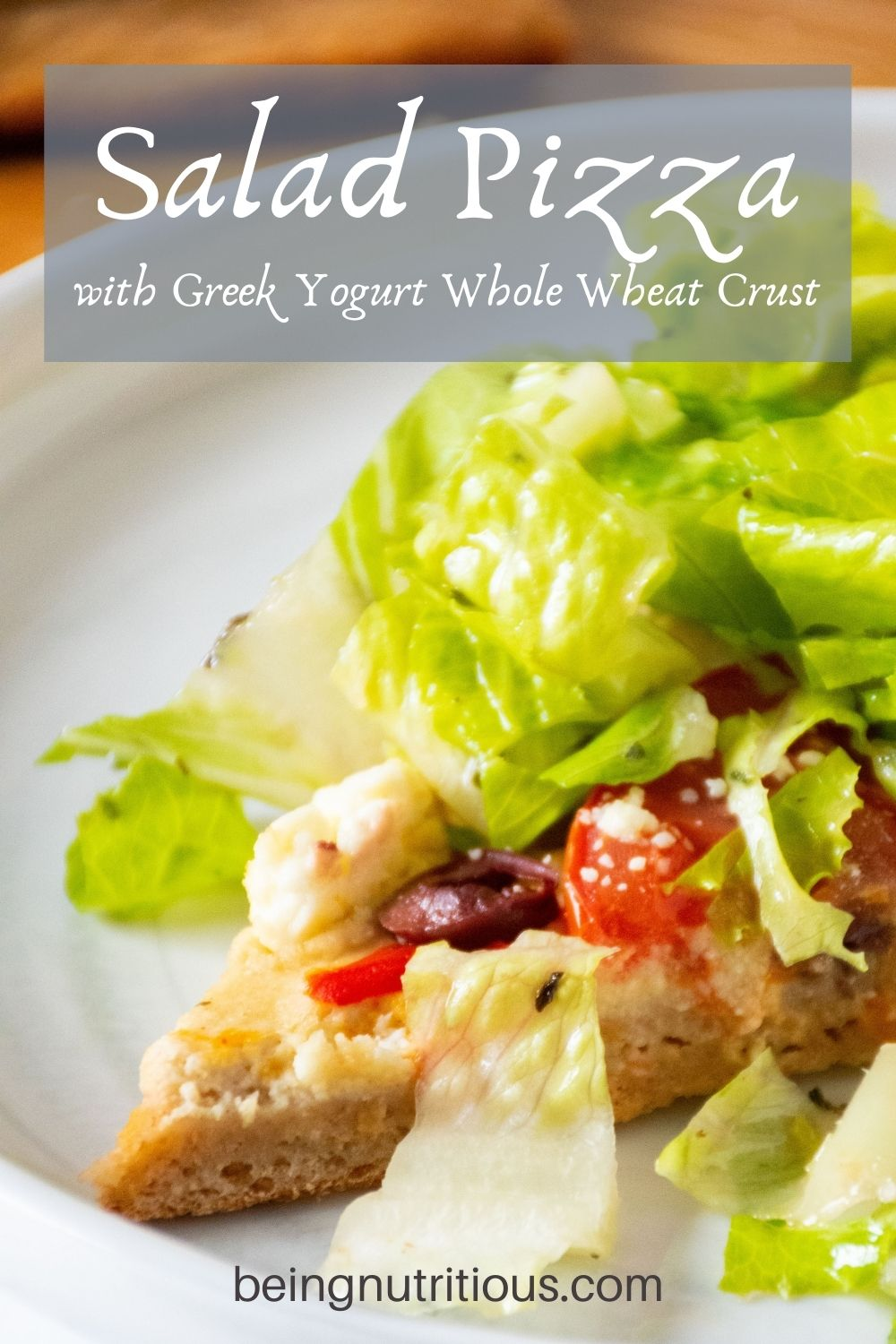 Slice of pizza topped with salad on a plate. Text overlay: Salad Pizza with Greek Yogurt Whole Wheat Crust.