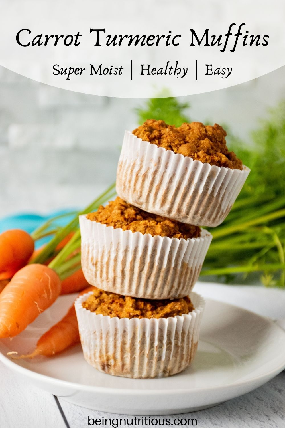 Stack of 3 muffins on a plate with fresh carrots in the background. Text overlay: Carrot Turmeric Muffins; super moist, healthy, easy.