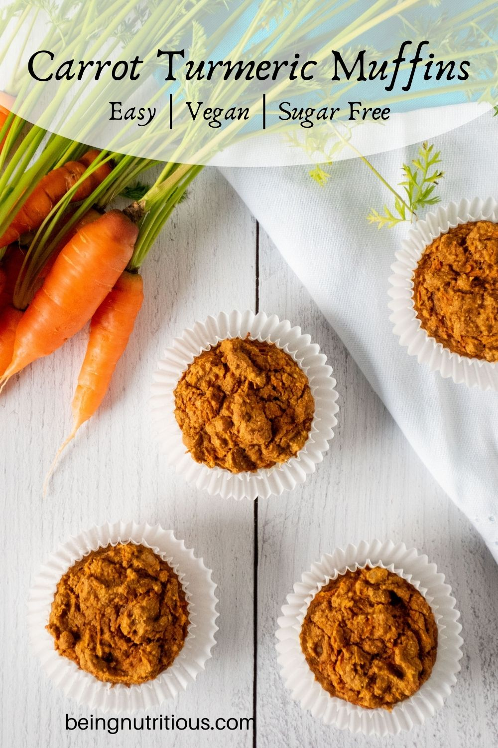 Muffins on a table with fresh carrots. Text overlay: Carrot Turmeric Muffins; easy, whole grain, sugar free.