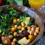 Kale salad in a wooden bowl.
