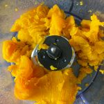 Pumpkin flesh scooped into food processor.