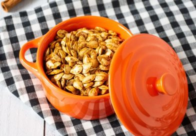 Small ceramic pot of roasted pumpkin seeds