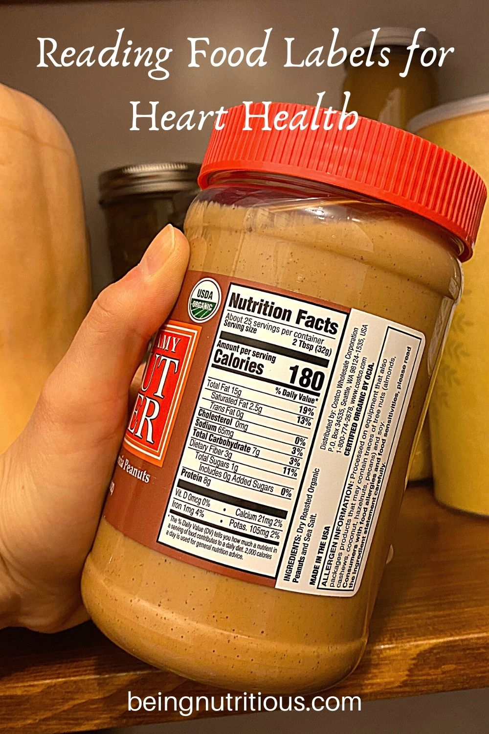 Hand holding a jar of peanut butter, with the nutrition facts label showing. Text overlay: Reading Food Labels for Heart Health