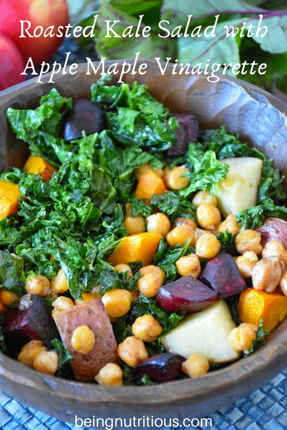 Kale salad in a wooden bowl. Text overlay: Roasted Kale Salad with Apple Maple Vinaigrette.