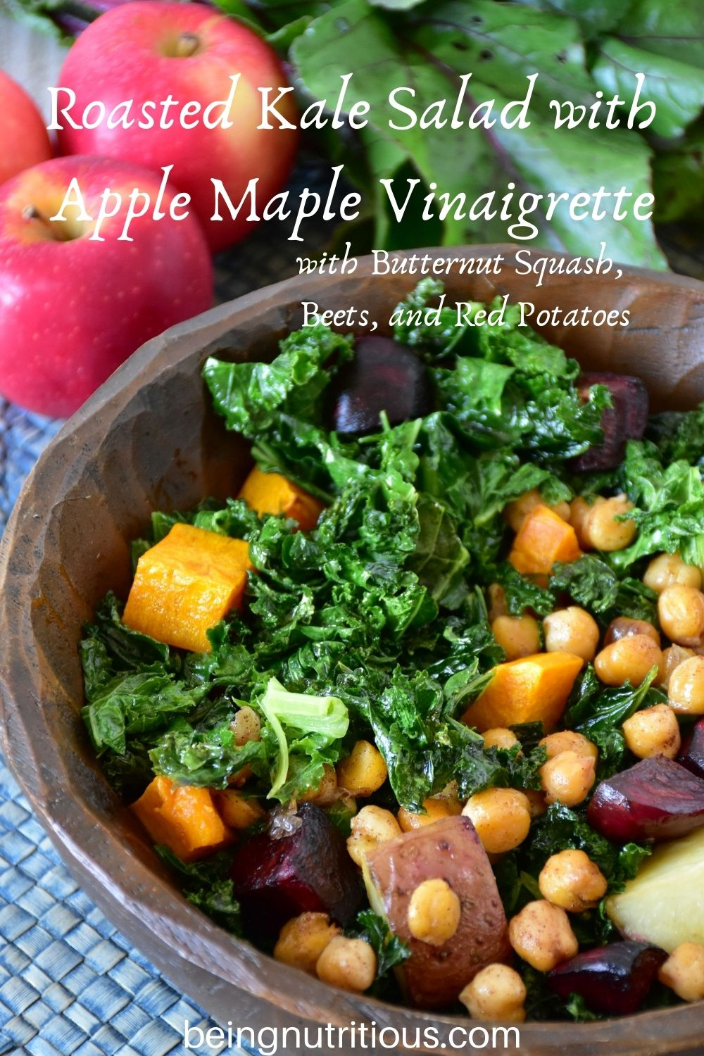 Kale salad in a wooden bowl. Text overlay: Roasted Kale Salad with Apple Maple Vinaigrette, with butternut squash, beets, and red potatoes.