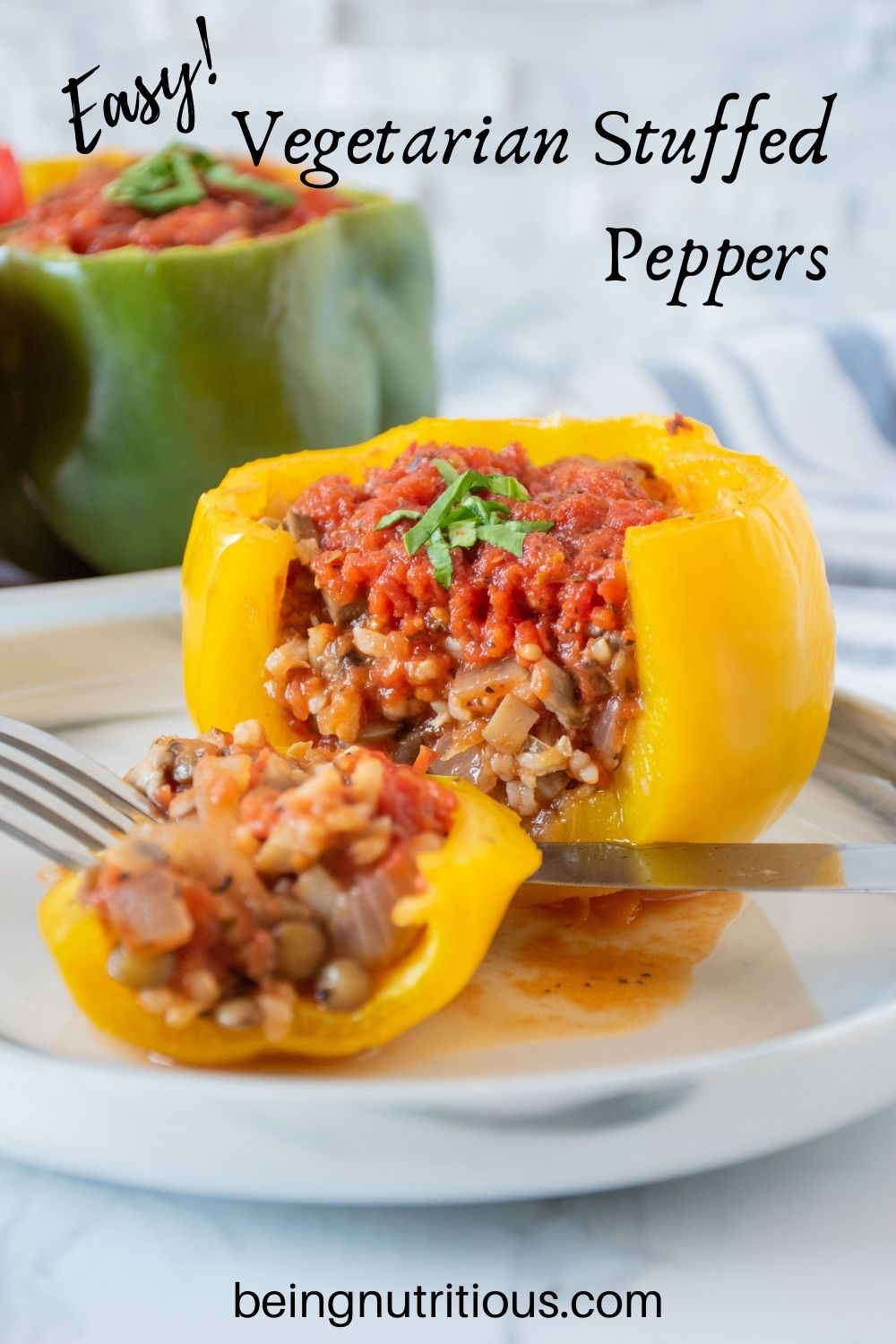 A yellow stuffed pepper, side cut open to reveal stuffing, on a plate. Text overlay: Easy! Vegetarian Stuffed peppers.