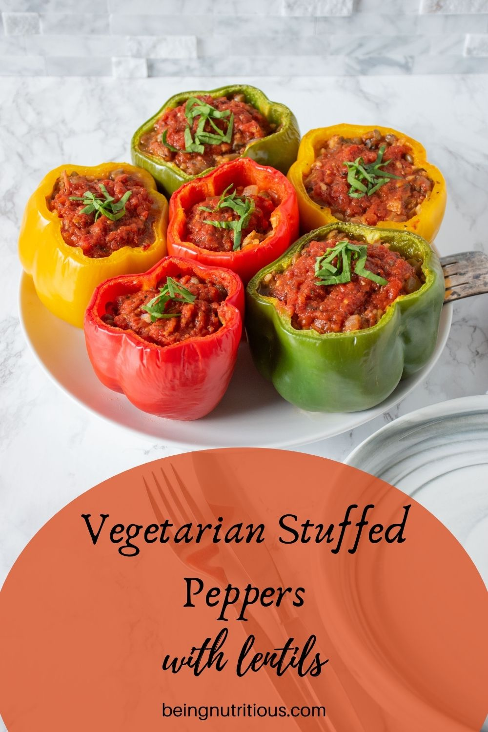 Six stuffed bell peppers on a round plate. Text overlay: Vegetarian stuffed peppers with lentils.