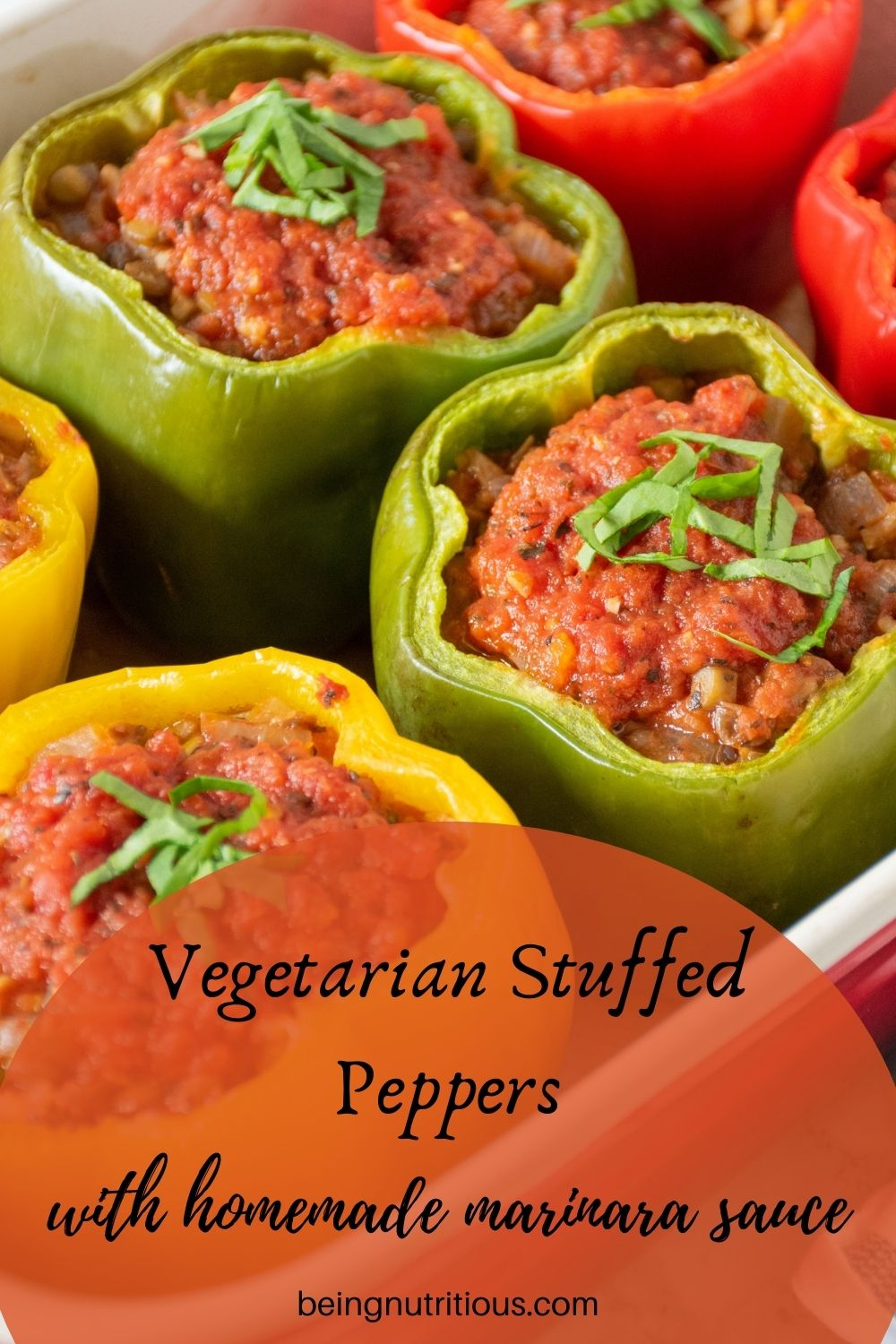 Close up of stuffed peppers in a baking pan. Text overlay: vegetarian stuffed peppers with homemade marinara sauce.