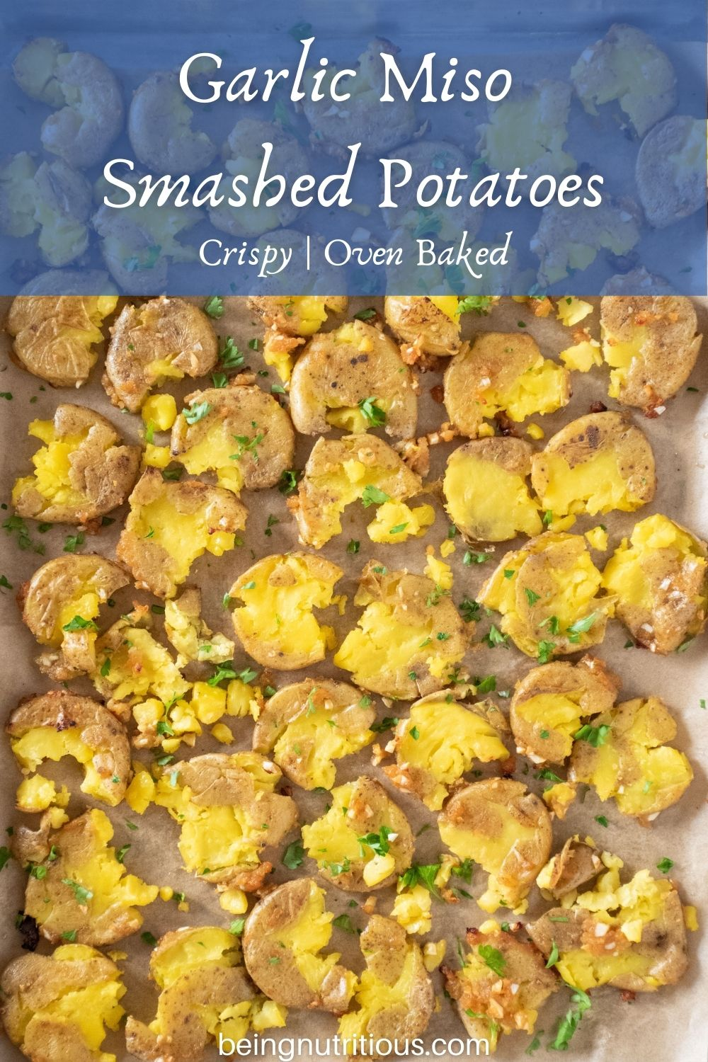 Overhead picture of smashed potatoes on a baking sheet. Text overlay: Garlic Miso Smashed Potatoes; crispy, oven baked.