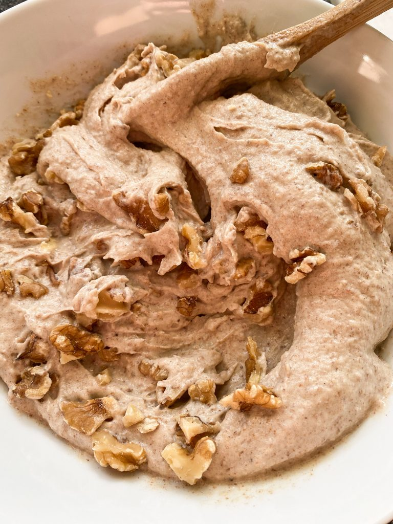 Nice cream in bowl with nuts