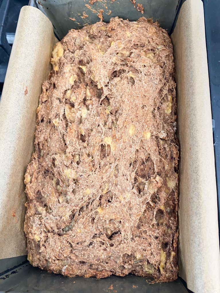Baked banana bread in loaf pan.
