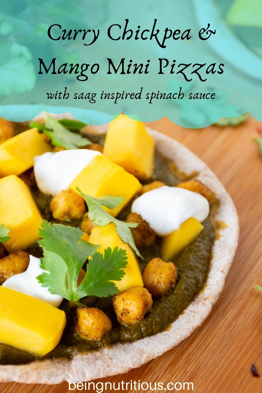 pizza with spinach sauce, chickpeas, and mangoes on a mini pita. Text overlay: Curry Chickpea & mango mini pizzas; with saag inspired spinach sauce.
