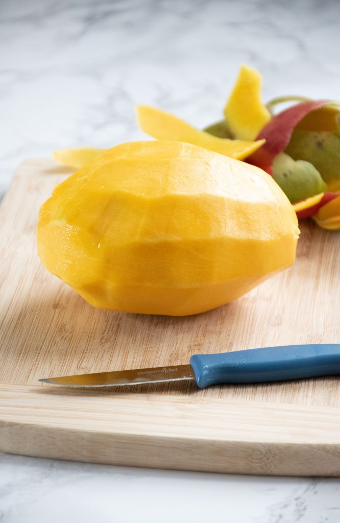 Whole mango with skin removed.