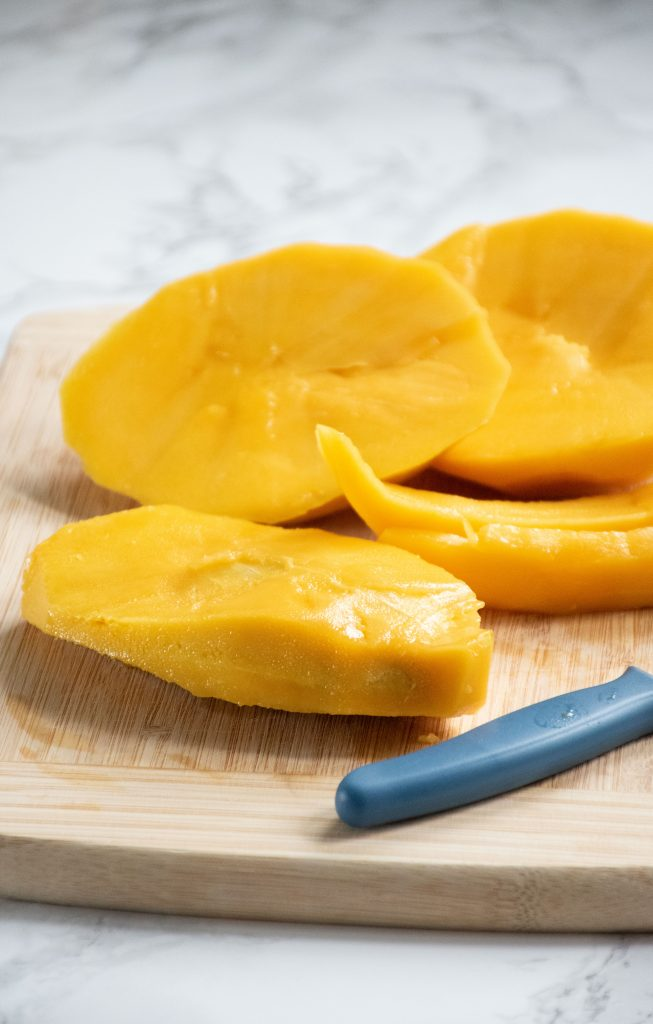 Mango seed with flesh removed.