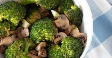 Roasted broccoli and mushrooms in a bowl.