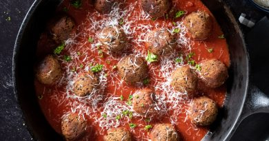 meatballs made of black beans in a large cast iron skillet with marinara sauce.