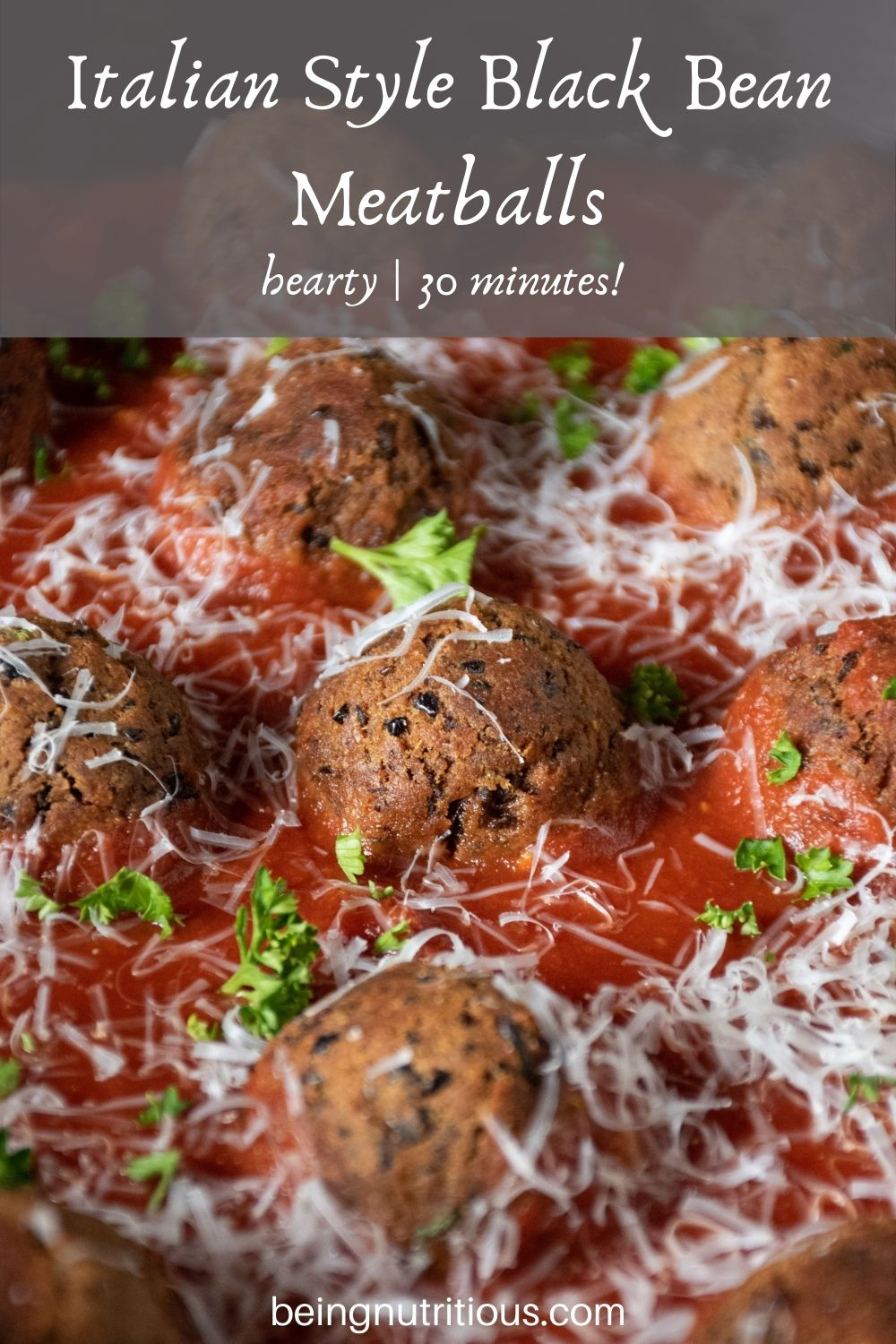 Skillet with meatballs made of black beans with marinara sauce. Text overlay: Italian Style Black Bean Meatballs; hearty, 30 minutes!