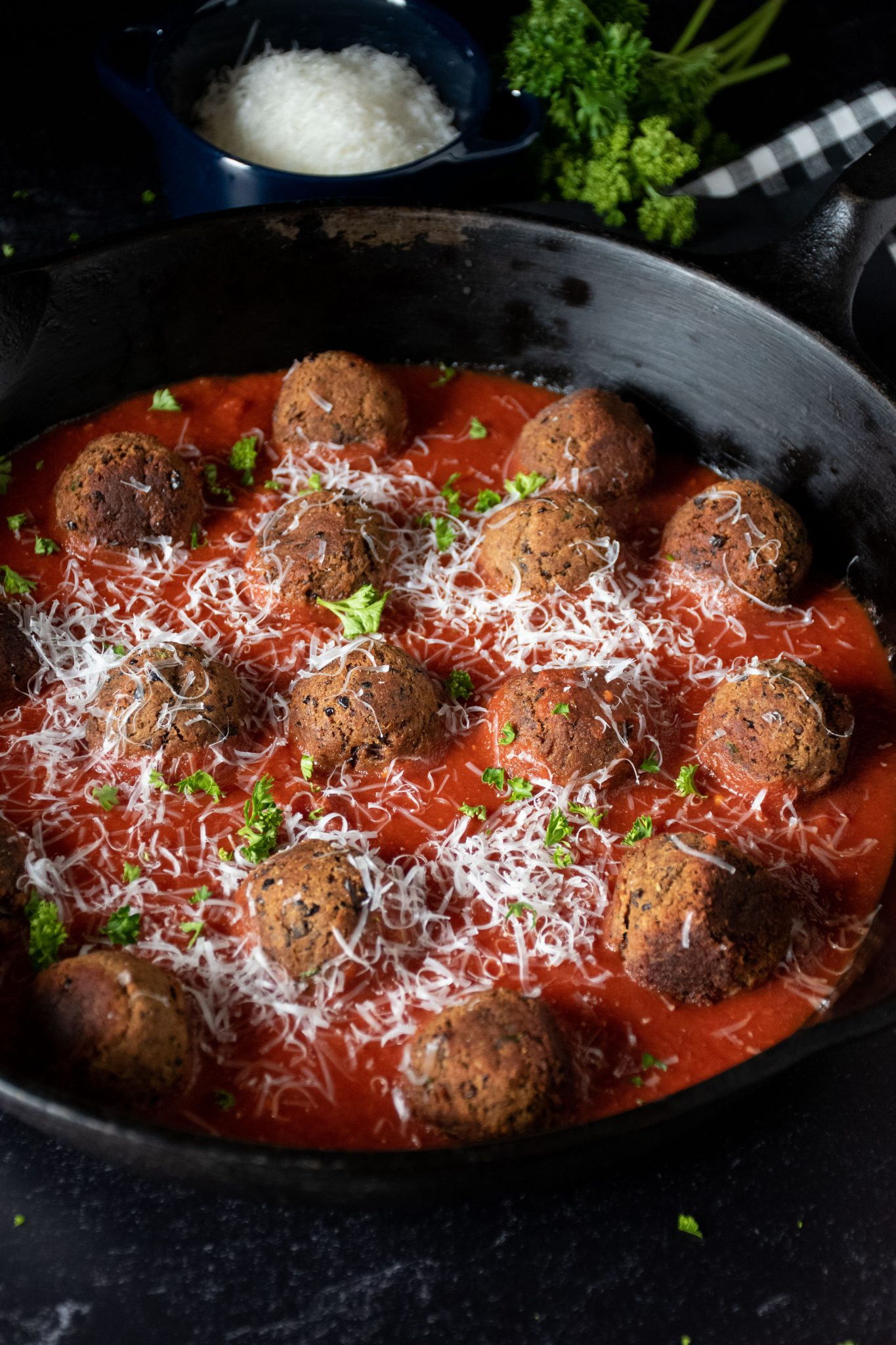 Skillet with meatballs made of black beans with marinara sauce.