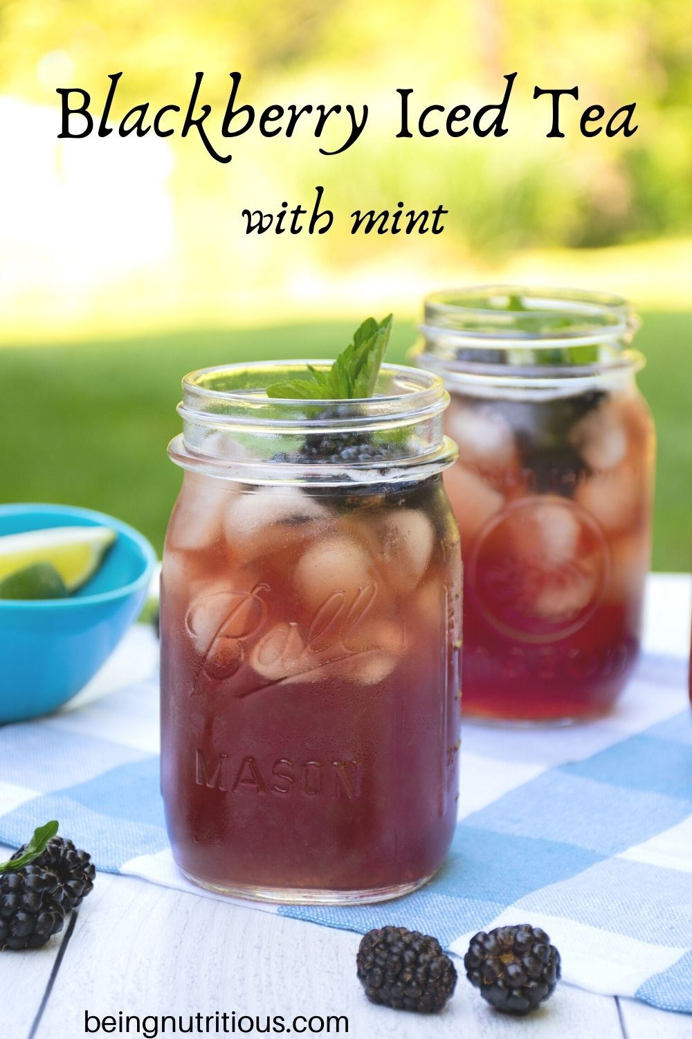 Iced tea in Mason jars, with ice, blackberries, and mint. Text overlay: Blackberry Iced Tea with mint.