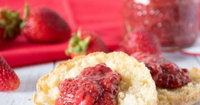 Toasted English Muffin with strawberry jam on it.