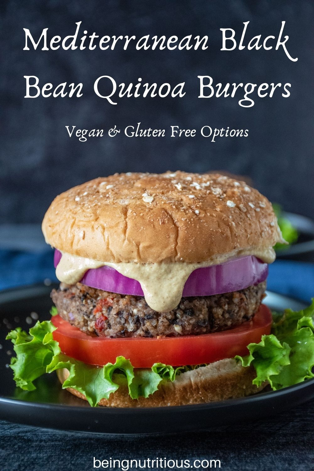 Bean burger on a bun, with onions, tomatoes, lettuce and sauce dripping out. Text overlay: Mediterranean Black Bean Quinoa Burgers; Vegan & Gluten Free Options.