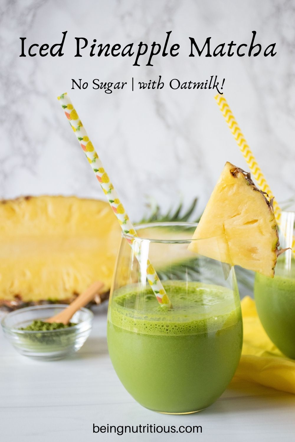 Glass of iced matcha drink, garnished with a pineapple slice. Text overlay: Iced Pineapple Matcha; no sugar, with oatmilk!