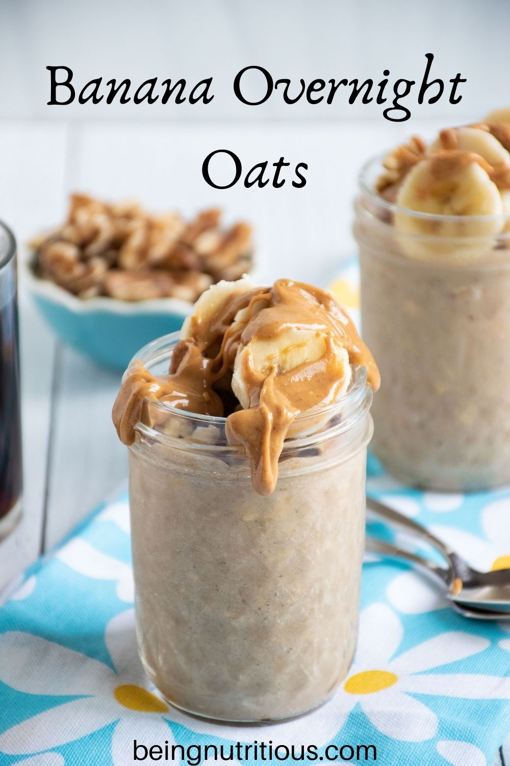 Small mason jar of oatmeal with walnuts and banana slices on top, with a drizzle of peanut butter. Text overlay: Banana Overnight Oats.
